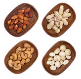 Macadamia, almond and cashew nuts isolated Royalty Free Stock Images