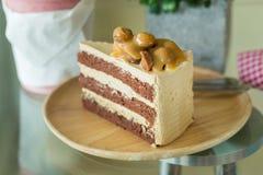 Macadamia cake on wooden plate Stock Photo