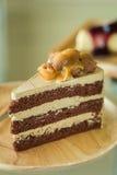 Macadamia cake on wooden plate Royalty Free Stock Photos