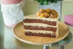 Macadamia cake on wooden plate Royalty Free Stock Image