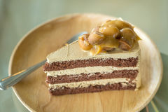 Macadamia cake on wooden plate Royalty Free Stock Photo