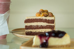 Macadamia cake on wooden plate Stock Photo