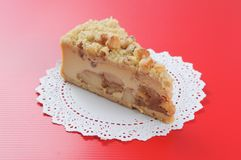 Macadamia Cheese cake on red background Stock Image