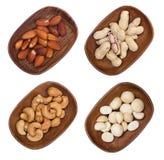 Macadamia, Mandel und Acajounüsse lokalisiert Lizenzfreie Stockbilder