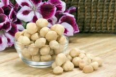 Macadamia Noten stock foto's