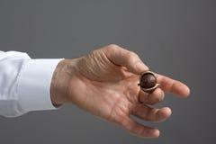 Macadamia nut in the man's hand. Stock Photo