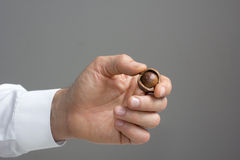 Macadamia nut in the man's hand. Royalty Free Stock Photo