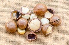 Macadamia nut on sack. Royalty Free Stock Photos