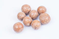 Macadamia nuts. Unshelled macadamia nuts on white background Stock Photos