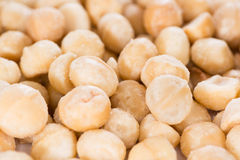 Macadamia nuts (background image). Portion of Macadamia nuts (roasted and salted) for use as background image or as texture stock images