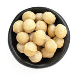 Macadamia Nuts in Black Bowl Overhead View Isolated Stock Image