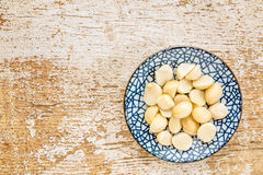 Macadamia nuts on ceramic bowl Royalty Free Stock Photo