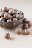 Macadamia nuts in coconut bowl Royalty Free Stock Image