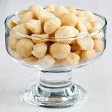 Macadamia. Nuts in the dessert bowl on white background Royalty Free Stock Photography