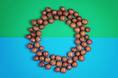 Macadamia nuts pattern on blue green background. Copy space stock photo