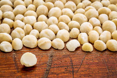 Macadamia nuts on rustic wood Royalty Free Stock Photography