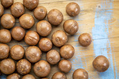 Macadamia nuts on rustic wood Stock Photography