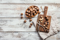 Macadamia nuts on table Royalty Free Stock Photos