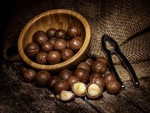 Macadamia nuts on wooden table. Royalty Free Stock Photos
