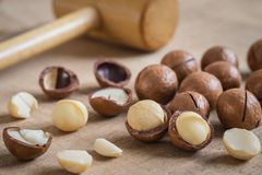Macadamia nuts on wooden table Stock Photos