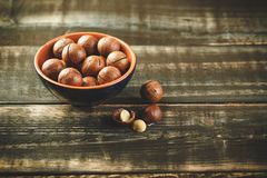 Macadamia nuts on wooden table stock image