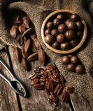 Macadamia, Pecan and Pili nuts on wooden table.  stock photo