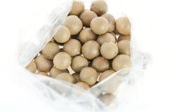 Macadamia in plastic bag Royalty Free Stock Photography