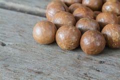 Macadamia on wood table. Stock Images