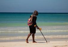Macao Beach, Bavaro, Dominican Republic, 10 april, 2019 / Man with metal detector searching the beach for coins or precious metals stock photos
