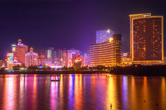 Macao Casino China. Macau, China - December 9, 2016: Cityscape with Wynn Macau, MGM Macauand Casino Lisboa, popular landmark reflecting in Nam Van Lake, a man Royalty Free Stock Image