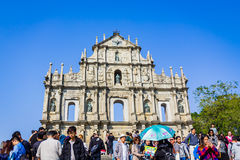 Macao, China - December 9, 2016: Tourists and local residents wa Stock Photo