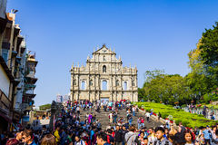 Macao, China - December 9, 2016: Tourists and local residents wa Royalty Free Stock Photo
