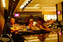 Macao, China: tourists dining in a restaurant Royalty Free Stock Photography