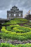 Macao landmark. Ruins of St. Paul's Cathedral with green park in night in Macau, China Stock Photography