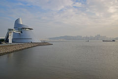 Macao Science Center with Amizade Bridge and Taipa Island. In the background having a mountain on the left and several tall buildings on the right Royalty Free Stock Photography