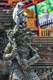 Macaque in the Hindu temple in Monkey Forest, Ubud, Bali Royalty Free Stock Images