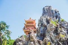 Macaque monkey jumping on rocks. Monkey Island, Vietnam. Nha Trang Stock Images