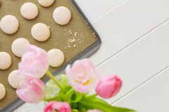 Macaron on baking sheet with crumbs Royalty Free Stock Images