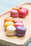 Macaron buttercream. Desserts colorful macaroons buttercream on wood tray royalty free stock photos