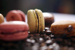 Macaron and coffee beans. Beige macaron and coffee beans as background Stock Photo