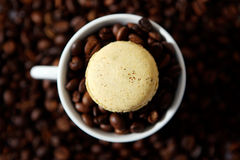 Macaron and coffee beans Stock Photo
