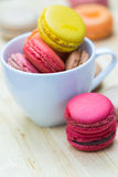 Macaron in coffee cup Stock Photography