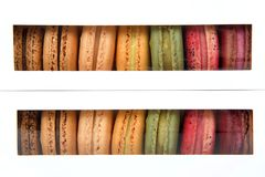 Macaron cookies in boxes with clear window. Macaron cookies in white boxes with clear plastic windows showing a display of colorful cookies royalty free stock photography