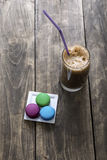 Macaron cookies and coffee on table Stock Photos