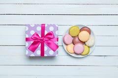 Macaron and gift Stock Photo