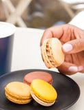 Macaron in hand royalty free stock photo