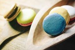 Macaron on ladle and bowl Royalty Free Stock Image