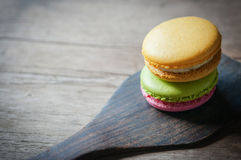 Macaron on ladle Royalty Free Stock Image