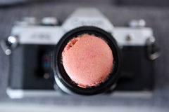 Macaron and a photo camera Royalty Free Stock Image