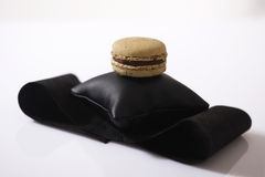 Macaron on a pillow Stock Images